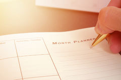Hand writing blank planning notebook on desk use us organizer schedule life or business planner concept Royalty Free Stock Images