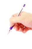 Hand writing with a blue ballpoint Stock Images