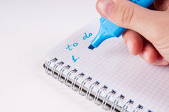 Hand writing by blue on empty notepad, white background Stock Images