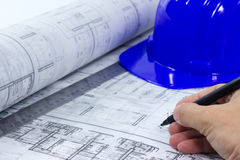 Hand writing on blue print with hard hat and ruler Stock Image