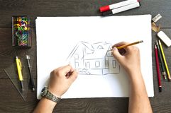 Hand writing on a blueprint Stock Photography