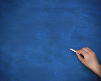 Hand writing on board with chalk Royalty Free Stock Images
