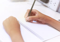 Hand writing on book Royalty Free Stock Image