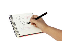 Hand writing on a book Royalty Free Stock Photos