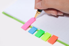 Hand writing on bookmark of notebook Royalty Free Stock Images