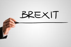 Hand writing brexit with magic marker on white Royalty Free Stock Photos