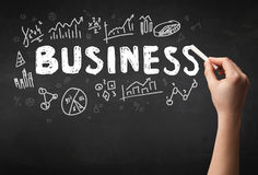 Hand writing business on blackboard Royalty Free Stock Photography