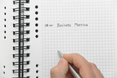 Hand writing business meeting details Stock Images