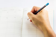 Hand writing on calendar Royalty Free Stock Photo