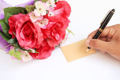 Hand writing card and rose Stock Photography