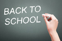 Hand writing with chalk back to school Royalty Free Stock Image
