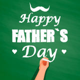Hand writing with chalk on chalkboard, happy father's day. Stock Image