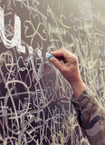 Hand writing with chalk on fulfilled board Stock Image