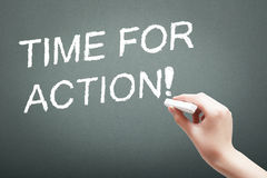 Hand writing with chalk time for action concept Stock Images