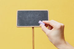 Hand writing on chalkboard Stock Image