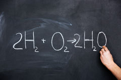 Hand writing chemical formula on blackboard Stock Photo