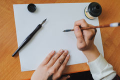 Hand writing chinese calligraphy Stock Images