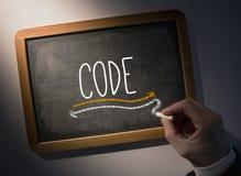 Hand writing Code on chalkboard Stock Photography