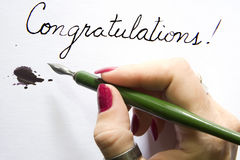 Hand writing congratulations  Stock Photo