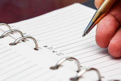 Hand writing a contact Stock Image