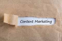 Hand writing Content Marketing concept at uncover envelope.  Stock Image