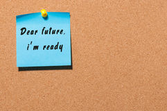Hand writing Dear Future I'm ready on blue sheet of paper at notice board with empty space Royalty Free Stock Photography