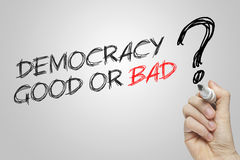 Hand writing democracy good or bad Royalty Free Stock Image