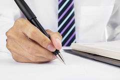Hand writing on the desk Royalty Free Stock Photography