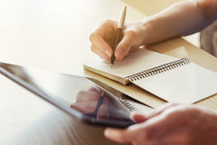 Hand writing with digital tablet Royalty Free Stock Photo