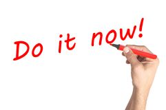 Hand writing Do it now on board Royalty Free Stock Image