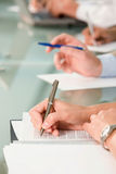 Hand writing on the document Royalty Free Stock Photo