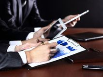 Hand writing in the document. Close-up picture of businessman's hand writing in the document Stock Photo