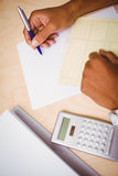 Hand writing documents at desk Royalty Free Stock Photos