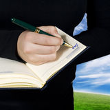 Hand writing down a note saying sold Royalty Free Stock Photo