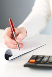 Hand writing down notes Stock Photo