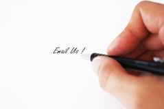Hand writing Email Us! on paper Stock Photos