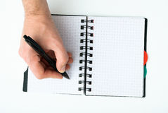 Hand writing on empty notepad Royalty Free Stock Photo