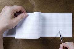 Hand writing on empty notepad Stock Photography