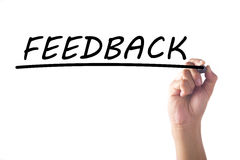 Hand writing FEEDBACK on transparent board Stock Image