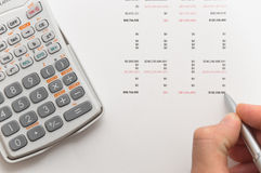 Hand writing figures on financial papers. Hand writing figures on financial balance sheet Stock Image