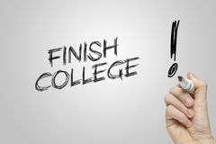 Hand writing finish college Royalty Free Stock Images