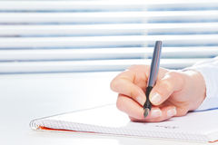 Hand writing with fountain pen at the table Stock Images