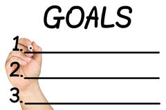 Hand Writing Goals Marker Glass Whiteboard. Male hand is about to write first goal with black felt-tip or marker on clear glass whiteboard isolated on white royalty free stock photography