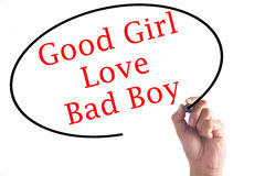 Hand writing Good Girls Love Bad Boys on transparent board.  Stock Photos