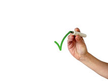 Hand writing a green check mark with green marker Royalty Free Stock Image