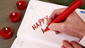 Hand writing happy new year stock footage