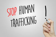 Hand writing human trafficking Stock Photos