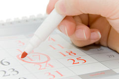 Hand writing important date. Close up royalty free stock photo