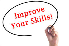 Hand writing Improve Your Skills on transparent board.  Royalty Free Stock Photos