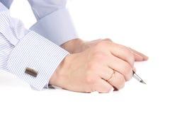 Hand writing ink pen. Male hand writing ink pen Royalty Free Stock Photos